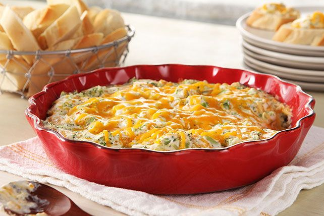 For an extra-warm welcome, bring this delicious hot cheese and broccoli dip to your next potluck.