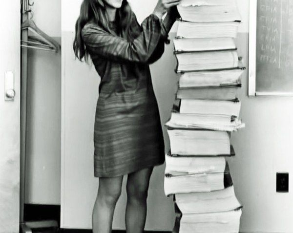 MARGARET HAMILTON with programs she & team wrote for Apollo missions