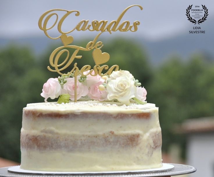 Wedding cake with sugar flowers and customized cake topper in gold...