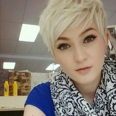 loving the delicate skin, deep focal point eyes and pale lips with the platinum blonde pixie-dixie !