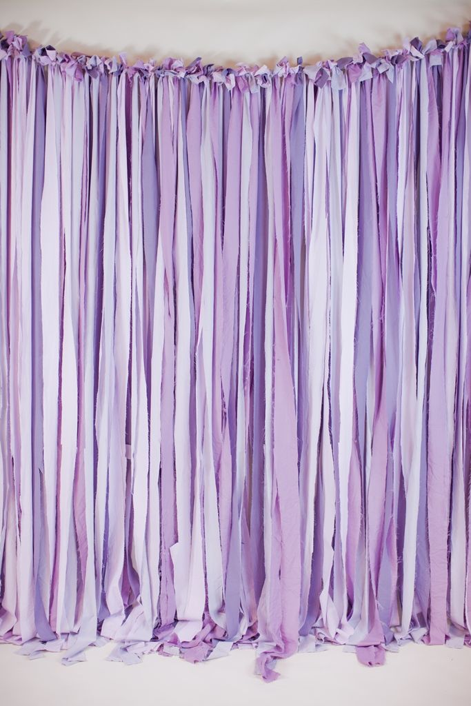 8' x 8' ribbon backdrop in shades of purple. also available to rent is a low profile aluminum frame if you don't have an area to hang this from.