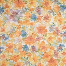 Watercolored tulips and wildflowers grace the background of this very textured Italian brocade. True blue, lavender and sunset orange, this palette will complement a range of complexions. The tiniest bit of a metallic sheen takes this fabric from ordinary to eye-catching. A summertime sheath or skirt would be stunning.