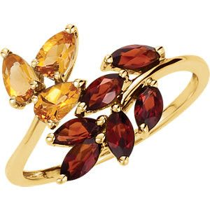 Citrine & Mozambique Garnet Leaf Design Bypass Ring. On your next vacation, don't forget to visit us in the fabulous Florida Keys! We offer unique nautical jewelry, treasure coins, fine jewelry and ha