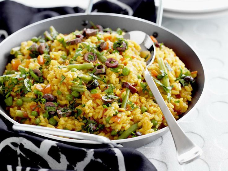 This colourful vegetarian paella strays slightly from the traditional form, but is well worth the adaptation.