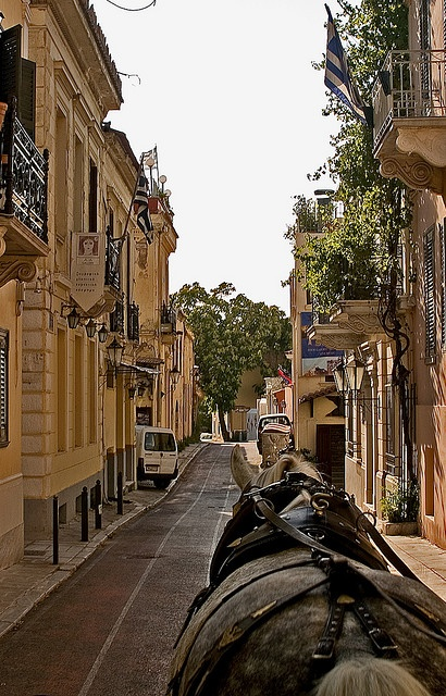 Plaka is the picturesque old historical neighbourhood of Athens, just under the Acropolis, incorporating labyrinthine streets and neoclassical architecture. It is visited by hundreds of thousands of tourists year round. Adrianou Street is the oldest street in Athens still in use.#solebike