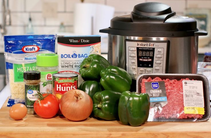 Instant Pot, lean ground beef, green bell peppers, yellow onion, tomato, diced Italian tomatoes, garlic powder, Italian seasoning, boil in a bag rice, shredded mozzarella cheese, egg