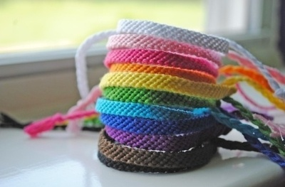 monochromatic rainbow friendship bracelets - maybe for encampment, each girl in the troop could do a different color and give them out as S.W.A.P.S.?