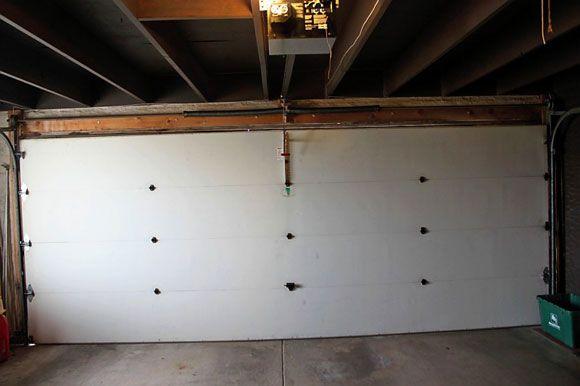 Photo #2: Before - the interior of the original garage door. My parents always wanted a garage door with windows.