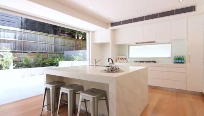 Kitchen.  Kitchen opens up into court yard.  Silver bar stools. Decorator: Jeni Jewell Designs