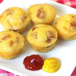 Baked Corn Dogs - used a pack of Jiffy, added 4-5 sliced up hot dogs & baked according to package.  Healthier option to fried. CORN DOGSSSSS!