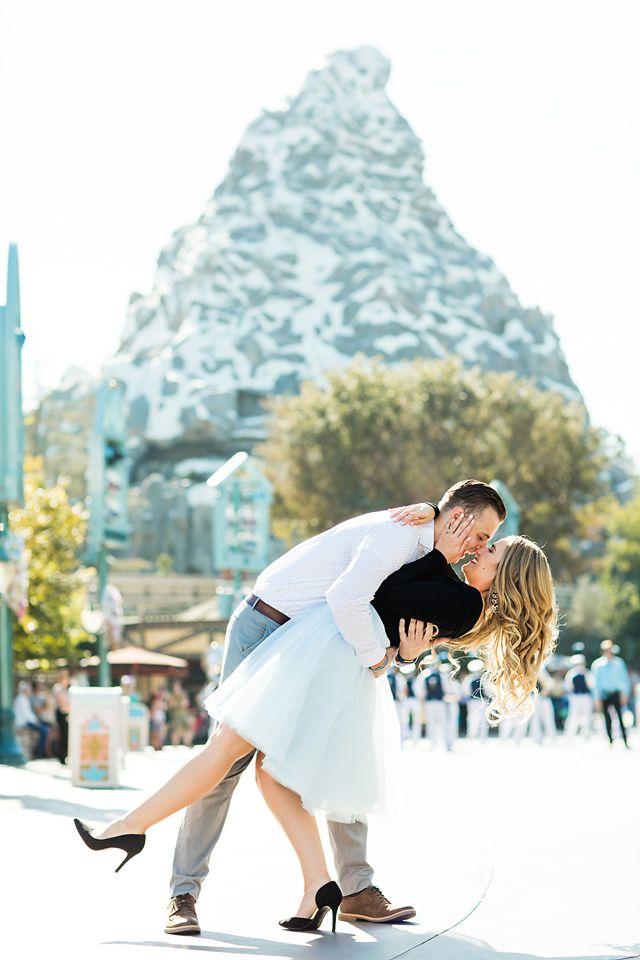 A gorgeous Disneyland engagement photo with a Matterhorn backdrop