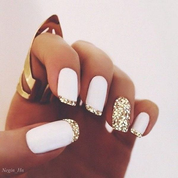 White Matte Polish and Gold Glitter French Tips Nail Design.