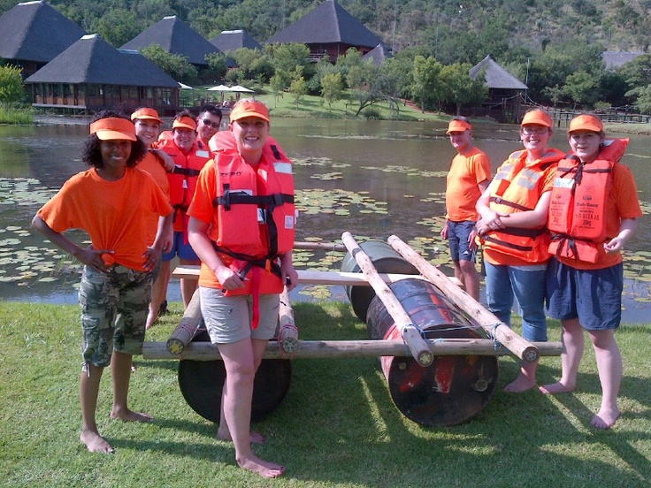 Another group from Upstream Advertising with their Raft Building Teambuilding on the dam at Intundla.