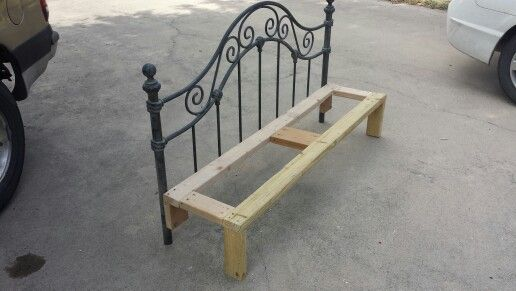 Wrought iron fullsize headboard. Built frame with 2x4s.