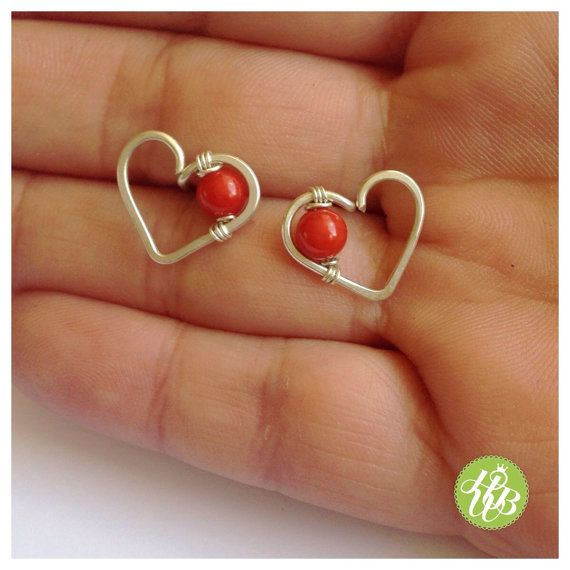 Coral heart stud earrings made of sterling silver. This gorgeous pair of silver studs are entirely handmade with 925 silver wire without soldering, totally hand shaped. If you are looking for a handcrafted small earring which is yet an eyecatcher, this coral studs are made for you.
