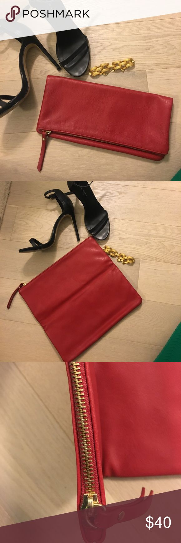Red fold over clutch handbag • Banana Republic red fold over clutch handbag • Only used once - perfect condition • Gold zipper at top Banana Republic Bags Clutches & Wristlets