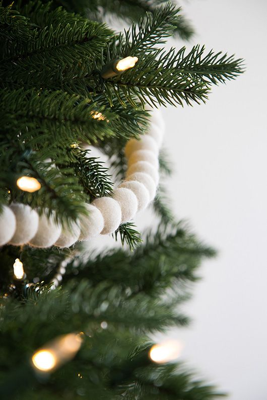 Use white decor on the Addison Spruce Tree to make a statement of understated elegance.