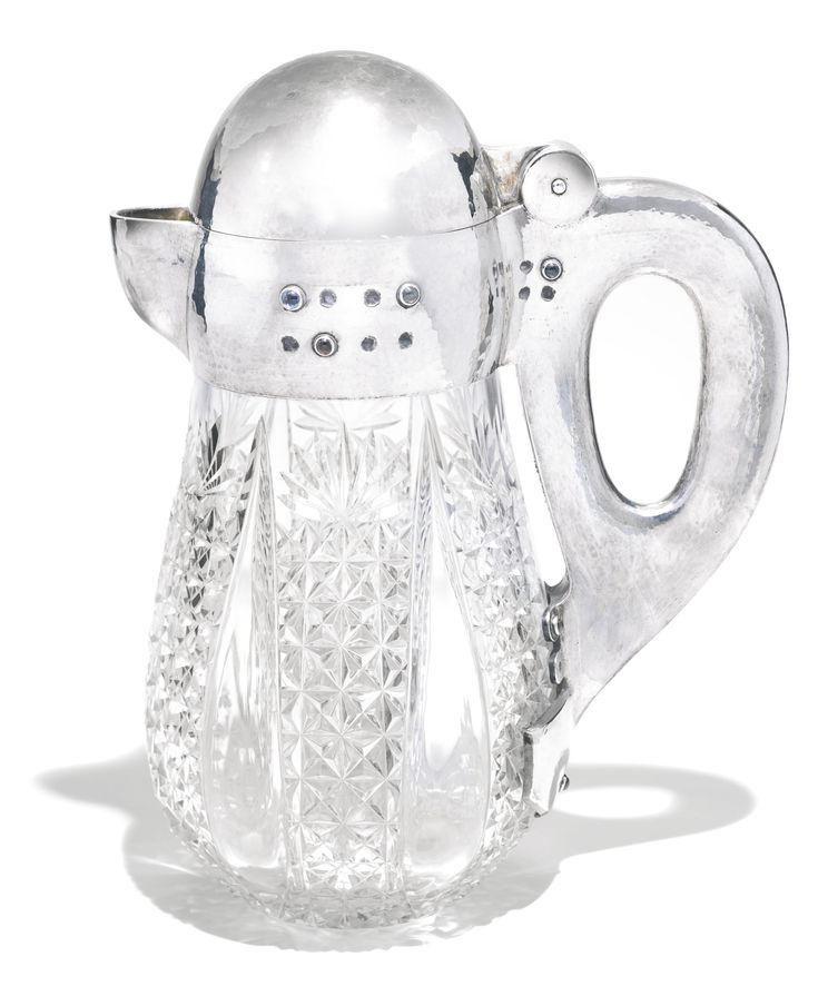 A rare Fabergé silver and glass ewer, Moscow, 1899-1908, in Scandinavian taste, the collar, lid and handle of hammered texture and applied with vari-coloured cabochons, the glass cut with diamond and fan facets within lobes, gilt interior, the interior rim later inscribed in Danish 'From the staff in Omsk/ AP 1.V.1935'.