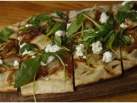 Amazing goat cheese flatbread with arrugula and caramelized onions ...