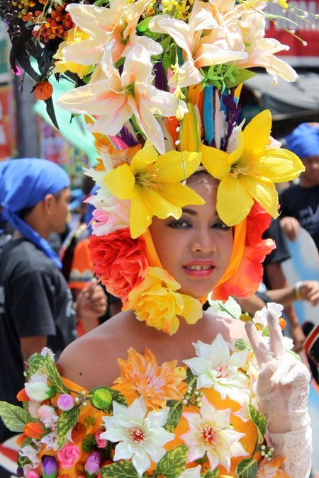 Flowergirl. She represents beauty and abundance of the city. Taken during Kadayawan festival at Davao City, Philippines. Travel Philppines!