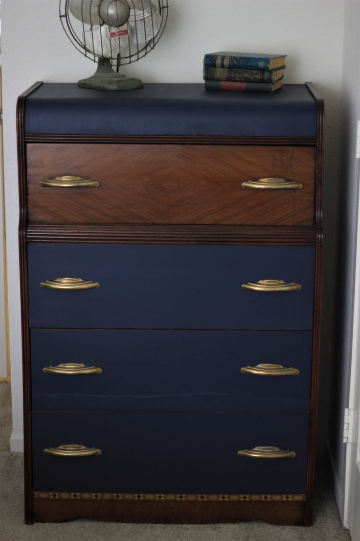 Navy and wood tone waterfall dresser