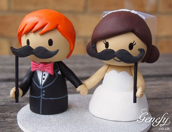 Cute Bride and Groom with moustache prop sticks wedding cake topper