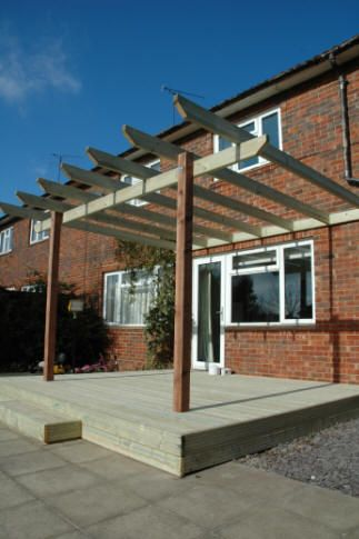 Small Decking Patio with Pergola want this but with concrete paver patio
