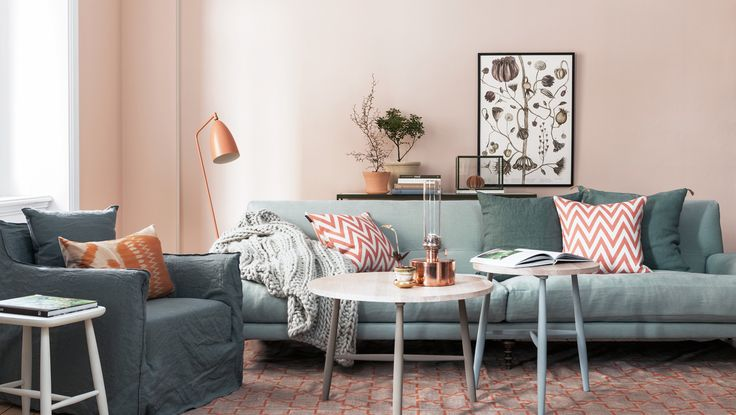 cozy grey coral and blush living room with chevron cushions and oversized knit throw