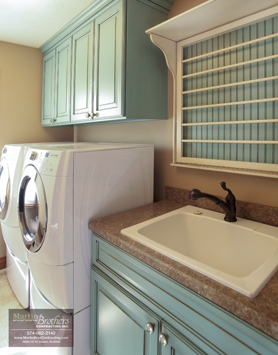 Love the color of the cabinets in this laundry room and the over-the-sink drying rack. Addition by Martin Bros. Contracting.