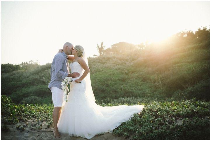 Brightgirl Photography. Kisses in sunset #brideandgroom #sunset #orchidbouquet #PalmDunes #KZNNorthCoast