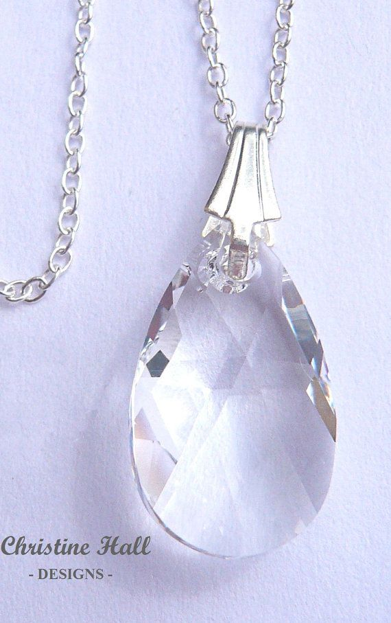 A stunning sparkly crystal pear pendant necklace, designed & handmade in my home studio. Beautiful clear crystal pear necklace. Photos taken in natural daylight.  This necklace has been made with SWAROVSKI ELEMENTS crystal.  Materials: - Clear pear crystal pendant (10mm wide x 16mm long approx.) - .925 Sterling Silver trace chain - .925 Sterling Silver bail and findings  Drop length of pendant (without chain): 2.2 cm (just under 7/8th inch) approx.  There are four lengths of chain av...