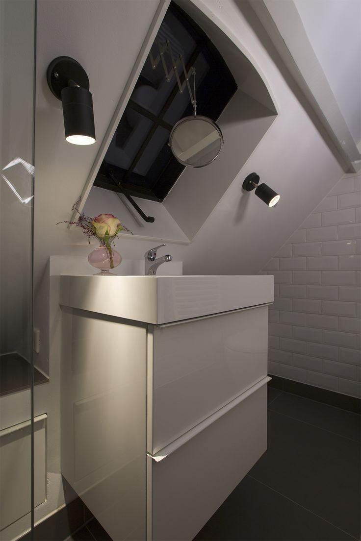 Steel roof windows in attic bathroom