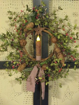 Primitive Christmas Wreath...with rusty bells and a grubby candle.