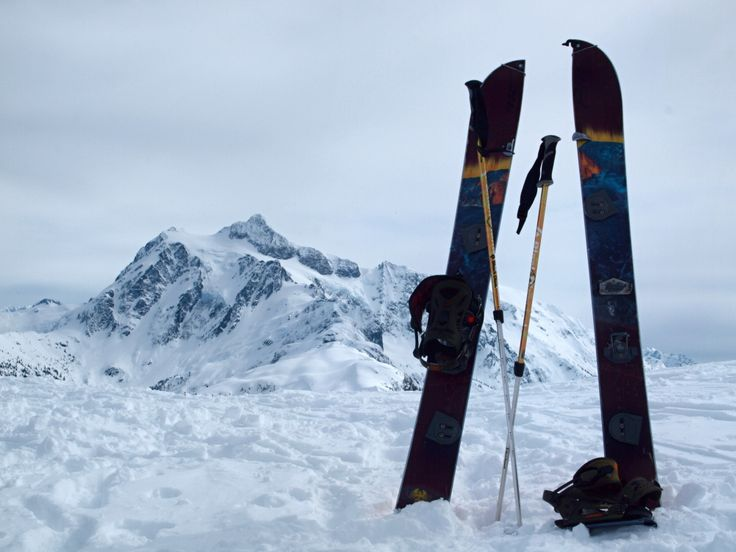 Splitboard and telescopic poles with the mountain.