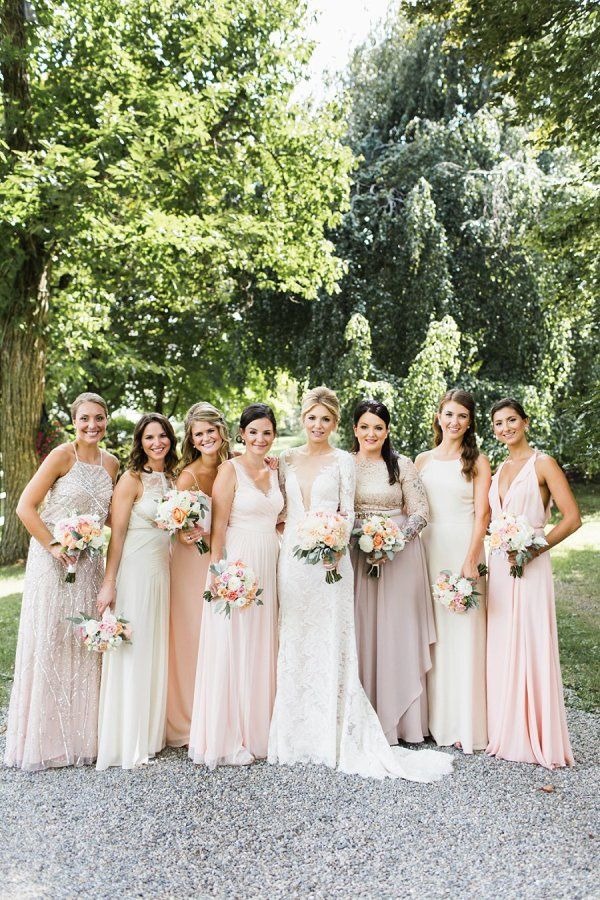 Neutral and blush bridesmaid dresses: http://www.stylemepretty.com/new-jersey-weddings/andover-township/2016/01/08/family-oriented-romantic-new-jersey-inn-garden-wedding/ | Photography: Julia Elizabeth - http://www.julia-elizabeth.com/