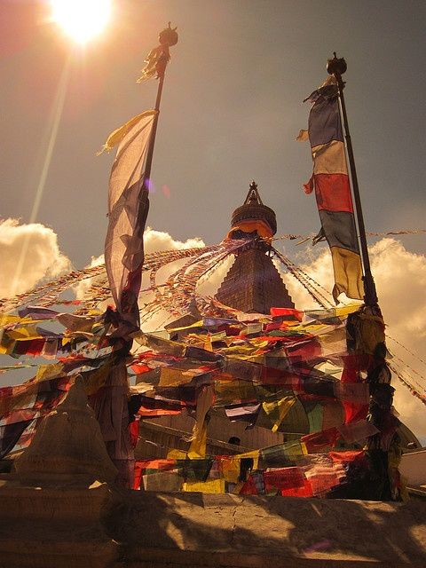 Swayambhunath (Nepal). 'The iconic whitewashed stupa of Swayambhunath is both a Unesco World Heritage Site and one of Nepal's most sacred Buddhist shrines. Beneath the iconic, all-seeing eyes of the stupa lies an eclectic mishmash of prayer flags, Buddha statues and Tibetan chapels. Pilgrims wander the shrines, spinning prayer wheels and murmuring mantras, while nearby astrologers read palms.'