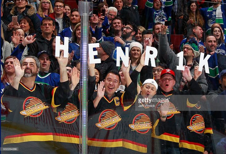 Vancouver fans hold up letters spelling out Henrik Sedin during the NHL game against the Florida Panthers at Rogers Arena January 20, 2017 in Vancouver, British Columbia, Canada. Vancouver won 2-1