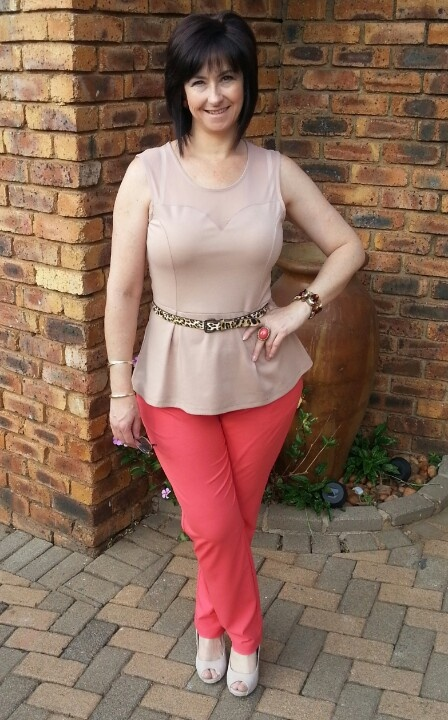 Coral trousers with peplum top