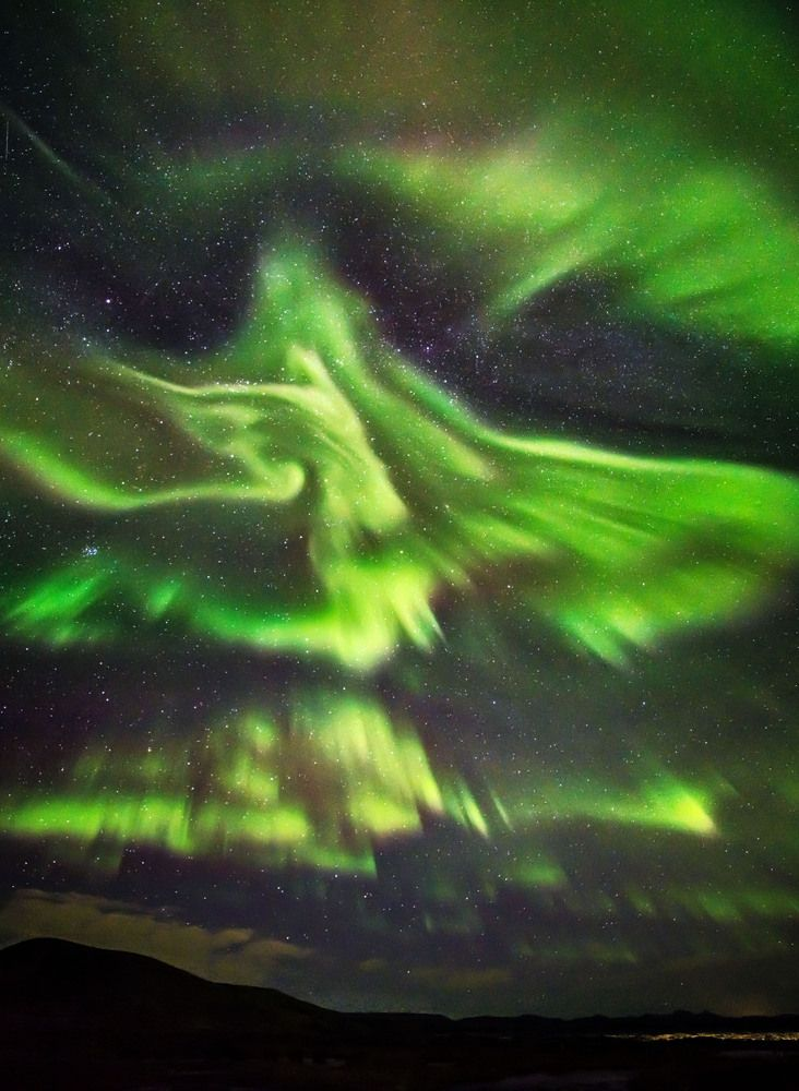 A photographer has captured remarkable images of the aurora borealis over Iceland, which resembles a huge phoenix rising about the icy land. Hallgrimur P. Helgason took the pictures in Kaldasel, which