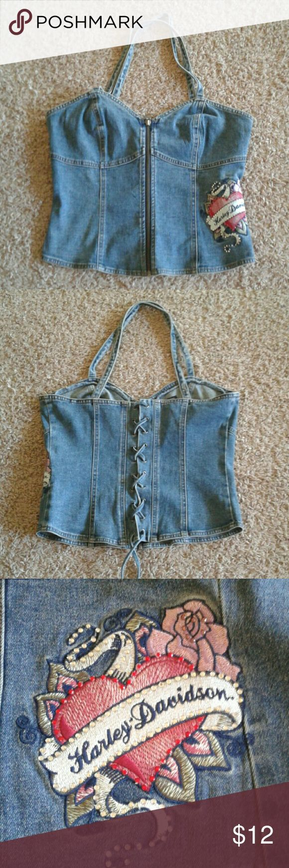 Harley Davidson Jean Halter Corset Top Size M Harley Davidson jean corset top size M.  In my opinion it fits more like a Large.  You could even go bigger by adjusting the corset back.  Here in the pics I have it tightened all the way.  Pretty embroidery on the side.  The front has full separating zipper, and the straps are somewhat adjustable as you can move to one more button hole.  Straps criss cross in the back.  Really cute and well made top ☺ Harley-Davidson Tops Tank Tops