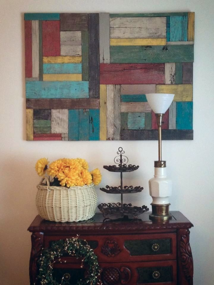 Stain pallet boards with watered down paint, put together for colorful art. This has all the colors for my livingroom!