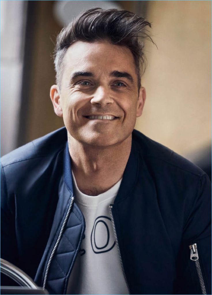 All smiles, Robbie Williams appears in a campaign for his Marc O'Polo collaboration.