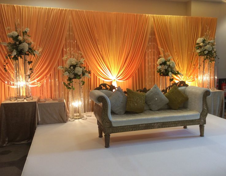 Stage floral arrangements  by Cathey;s flowers