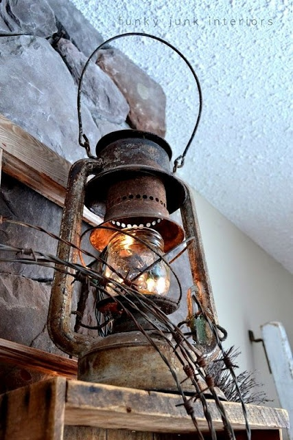 Stuff Christmas lights in an old rusty lantern for mantle. Neat Idea