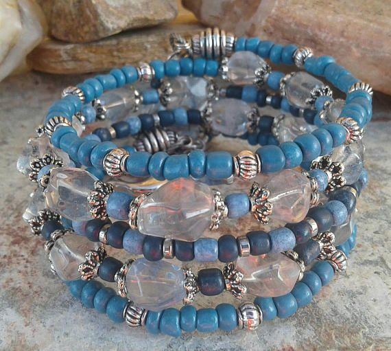 Check out this item in my Etsy shop https://www.etsy.com/listing/537748183/blue-glass-bead-silver-memory-wire