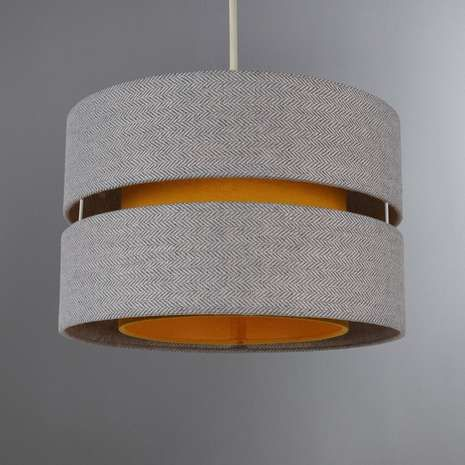 Made with a double tier design, this fabric light shade is crafted from cotton in a bright ochre tone highlighted by a grey tweed texture....