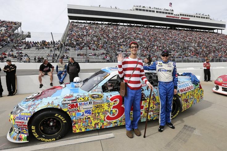 """The official """"Where's Waldo"""" celebrated his 25th anniversary by making his first-ever appearance at a NASCAR track. Waldo watched David Ragan race the No. 34 Where's Waldo Ford Fusion at Martinsville Speedway. The die-cast of Ragan's car is available for order now at the NASCAR Superstore or your hometown die-cast dealer."""