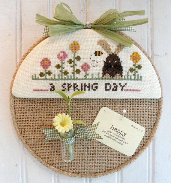 Burlap covered message board with cross stitched spring design