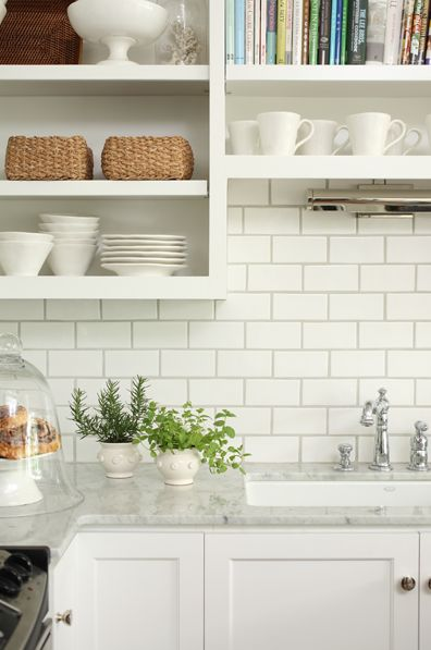 here is white subway tile with gray counter top.  Just not sure yet what I am going to get