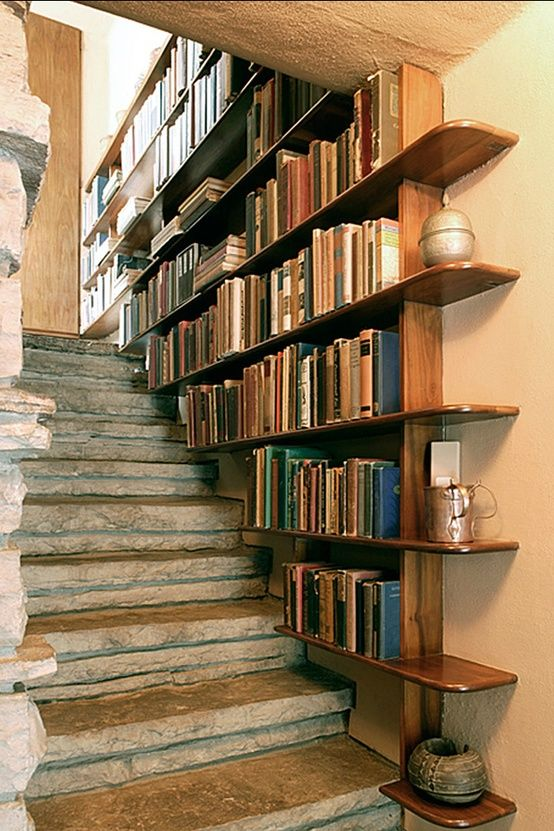 """Not such a huge fan of the bookshelf in itself (not fond of the """"cross-hatch"""" bookshelf idea), but the combined with the stairs, it looks pretty nice!"""